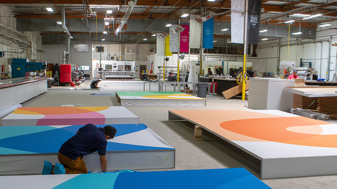grand large format print production facility fabric graphics color cars retail events trade shows sports corporate interior design wallpaper branding marketing cmyk super color innovative creative visual communications experiences