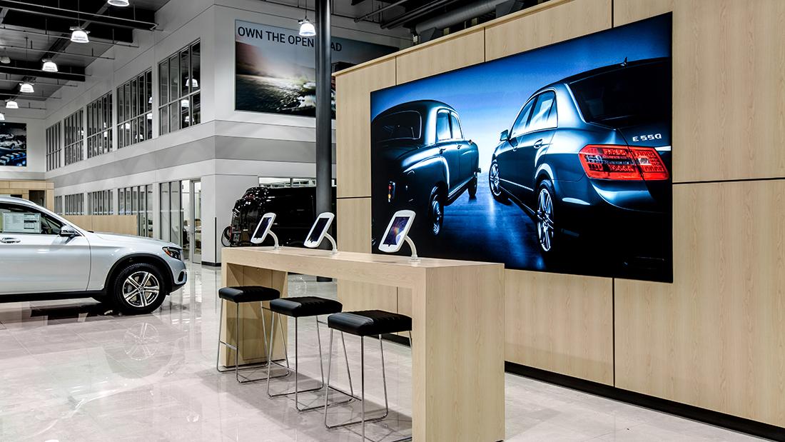 Automotive Dealership Interior Design Visual Graphics SEG Metal Frames Fabric Graphics Wallpaper Vinyl Decal Branded Marketing Mercedes Benz Luxury Lightbox Illumination Visual Communications Visual Design